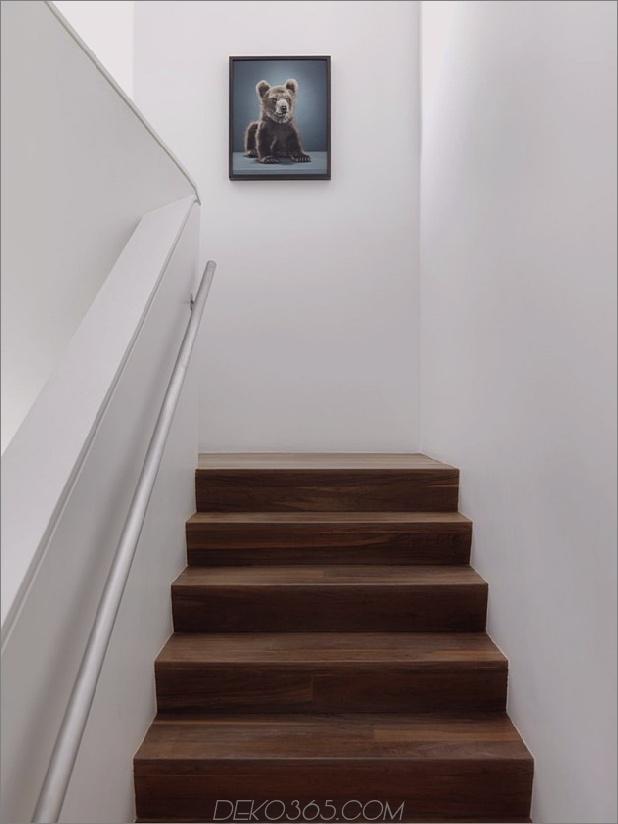 modernistisches Reihenhaus mit verschwindenden Wänden und minimalistischem Interieur-16.jpg