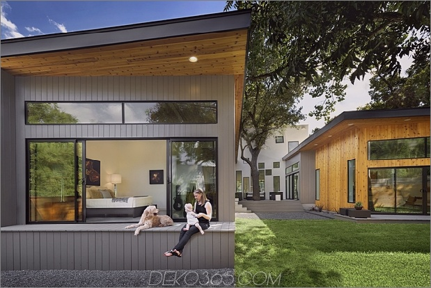Mutiges und modernes U-förmiges Hofhaus, entworfen um Bäume_5c58f590f0345.jpg
