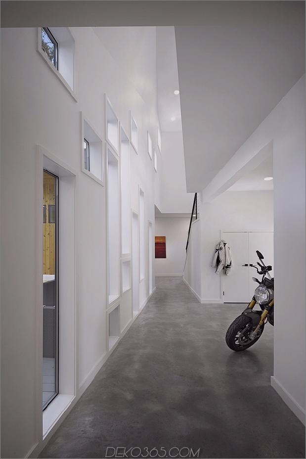 Mutiges und modernes U-förmiges Hofhaus, entworfen um Bäume_5c58f594460a9.jpg