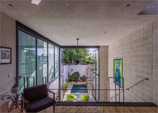 9-dünne-beton-home-doppelthohe glastüren.jpg