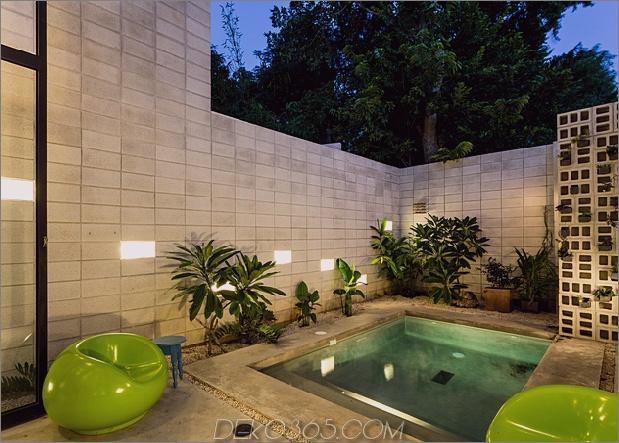 Skinny Concrete Home mit doppelthohen Glastüren_5c58e27c62d68.jpg