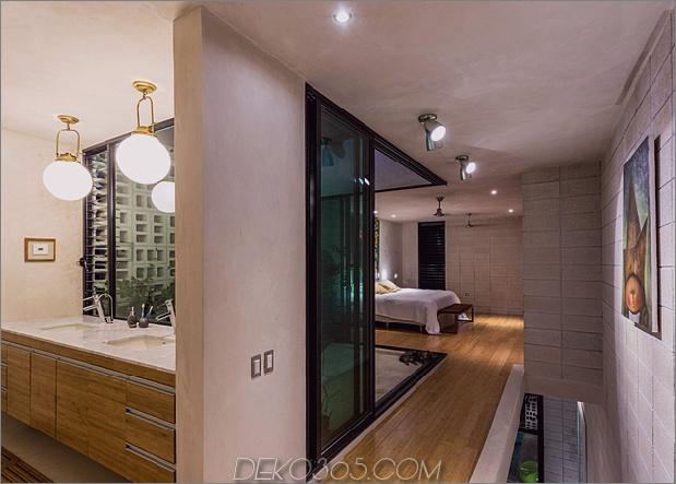 Skinny Concrete Home mit doppelthohen Glastüren_5c58e2811a8d1.jpg