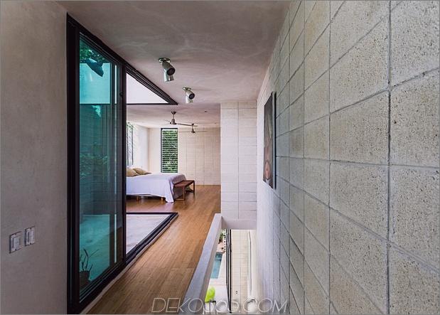 Skinny Concrete Home mit doppelthohen Glastüren_5c58e281936be.jpg