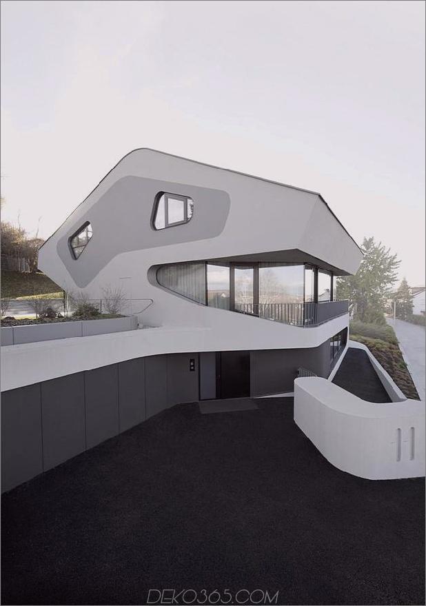 Stahlbeton-Haus-mit-Aluminium-Fassade-3-Seiten-Einfahrt.jpg