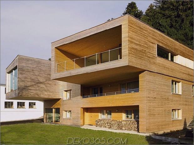 skulpturales Holzhaus mit gestapelten Ergänzungen für drei Familien 4.jpg