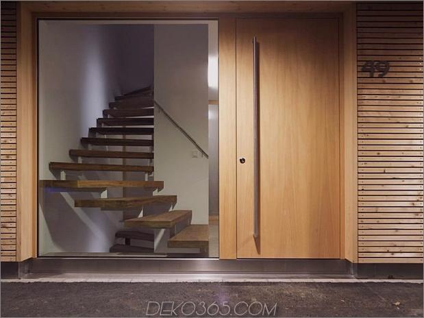 skulpturales Holzhaus mit gestapelten Zusätzen für drei Familien 5.jpg