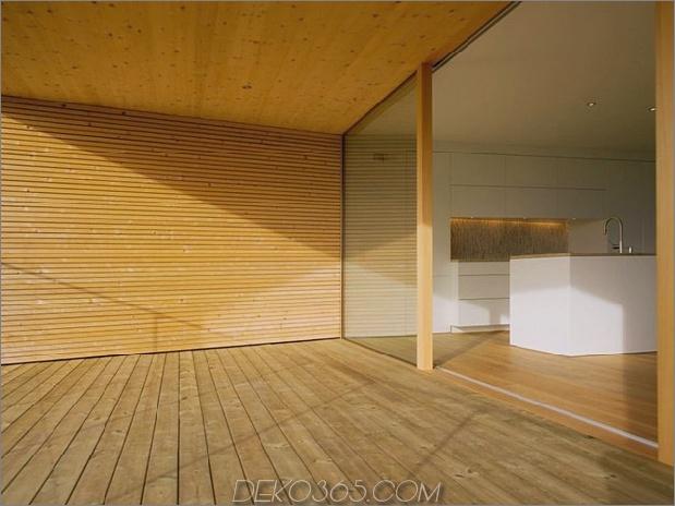 skulpturales Holzhaus mit gestapelten Ergänzungen für drei Familien 6.jpg