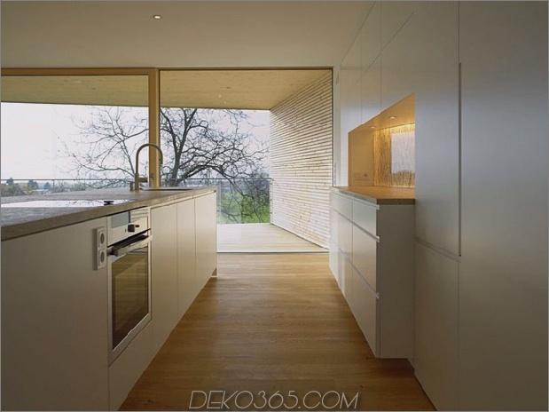 skulpturales Holzhaus mit gestapelten Ergänzungen für drei Familien 8.jpg