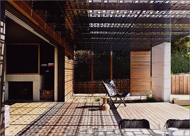 Strandhaus-geometrische-schirme-gebaut-Sanddünen-8-Kamin.jpg