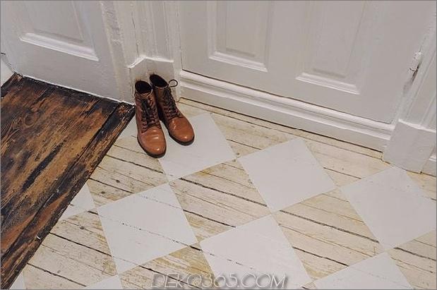 Schablonen-Schachbrettmuster-Foyer-rustikal-Holzböden.jpg