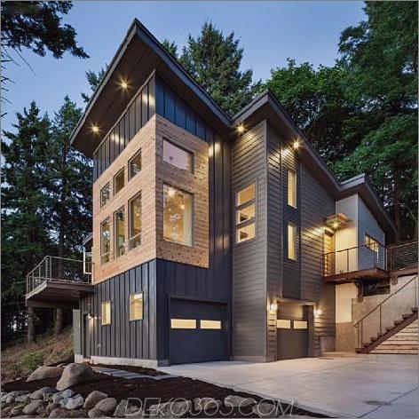 modernes vertikales Haus ragt zwischen den Bäumen hoch Vertical Mountain Cottage ragt zwischen den Bäumen hervor