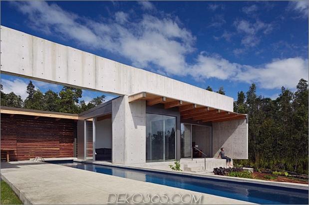 cool-beton-haus-mit-glas-wänden-fängt-outdoor-living-3.jpg ab