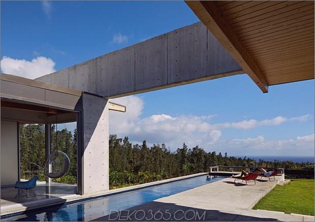 cool-beton-haus-mit-glas-wänden-fängt-outdoor-living-4.jpg ab