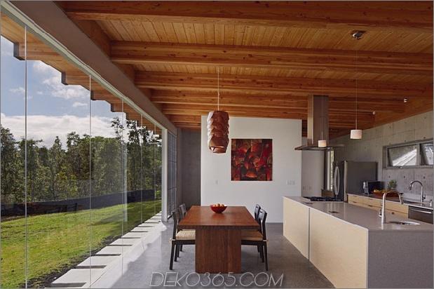 cool-beton-haus-mit-glas-wänden-fängt-outdoor-living-7.jpg ab