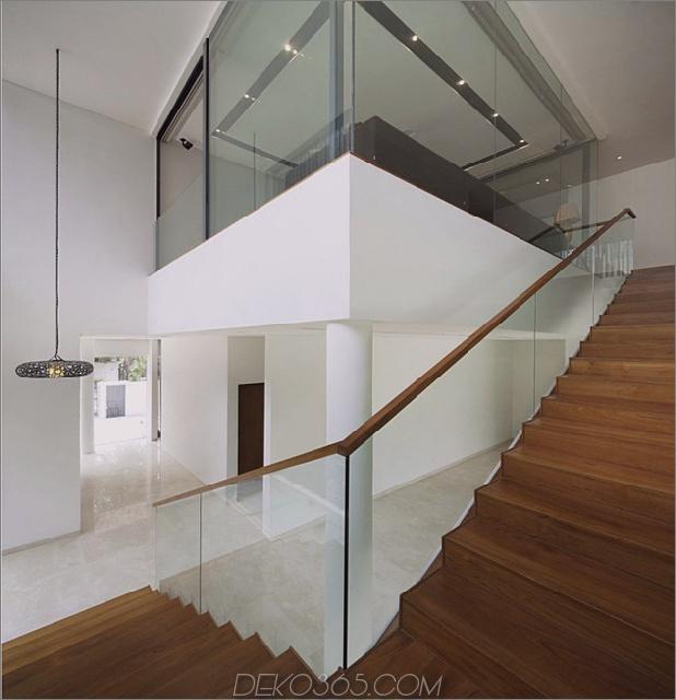 windgewölbe-haus-mit-gekrümmten dach-und-glas-sockel-10.jpg