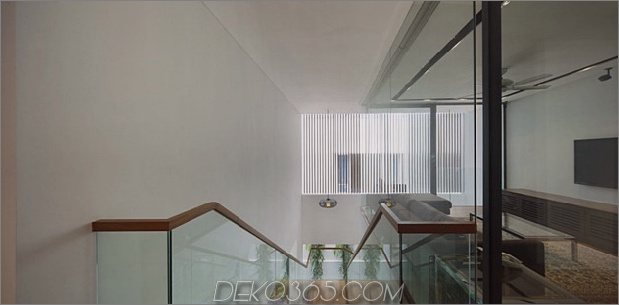 windgewölbe-haus-mit-gebogenem dach-und-glas-sockel-11.jpg