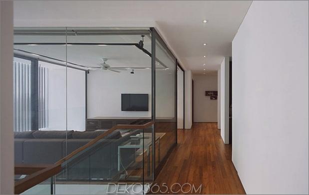 windgewölbe-haus-mit-gebogenem dach-und-glas-sockel-12.jpg