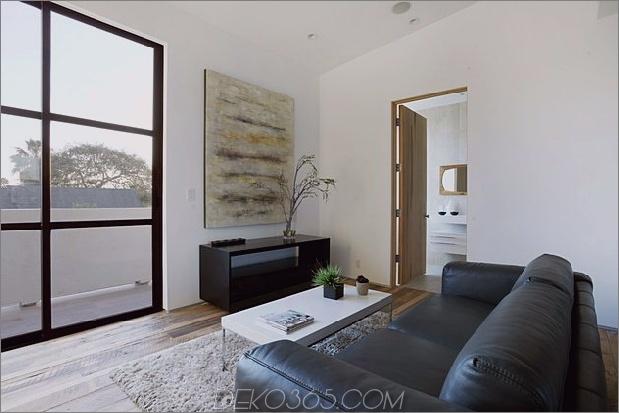 Zeitgenössisches Haus mit Pool hat Schwarz-Weiß-Interieur_5c598f7da8169.jpg