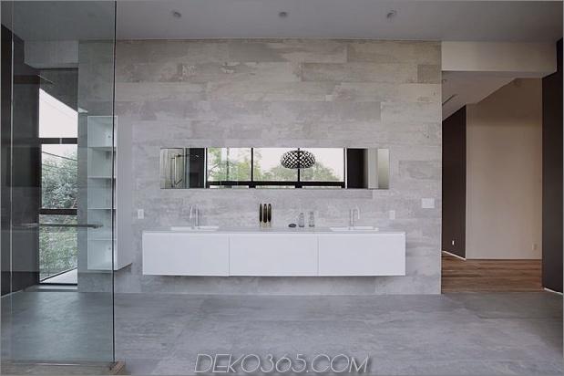 Zeitgenössisches Haus mit Pool hat Schwarz-Weiß-Interieur_5c598f8194047.jpg