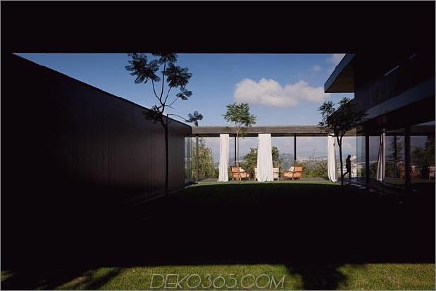 black-home-with-bright-interior-einbau in grasbewachsenen hang-9-second-floor-shadow.jpg