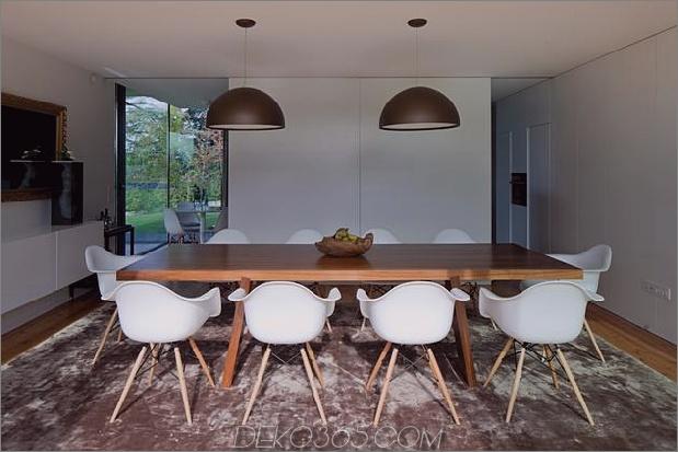 black-home-with-bright-interior-einbau in grasige hügel-19-esszimmer.jpg