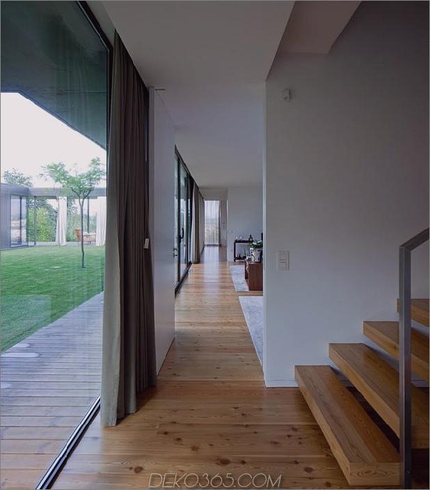 black-home-with-bright-interior-einbau in grasige hügel-21-bottom-open-hallway.jpg