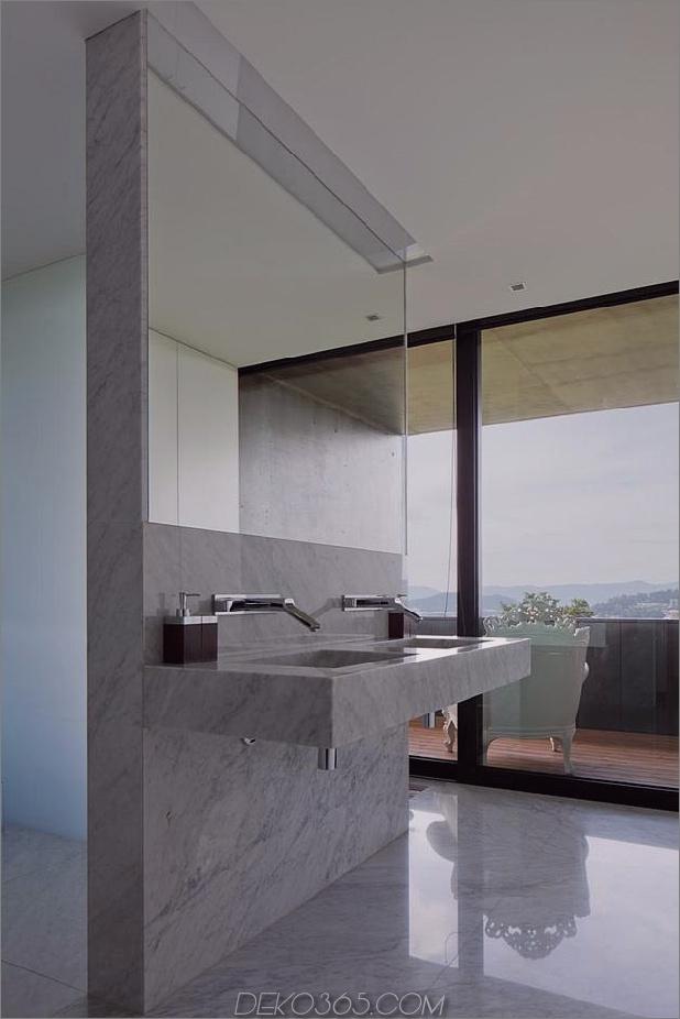 black-home-with-bright-interior-einbau in grasige hügel-26-master-bathroom.jpg