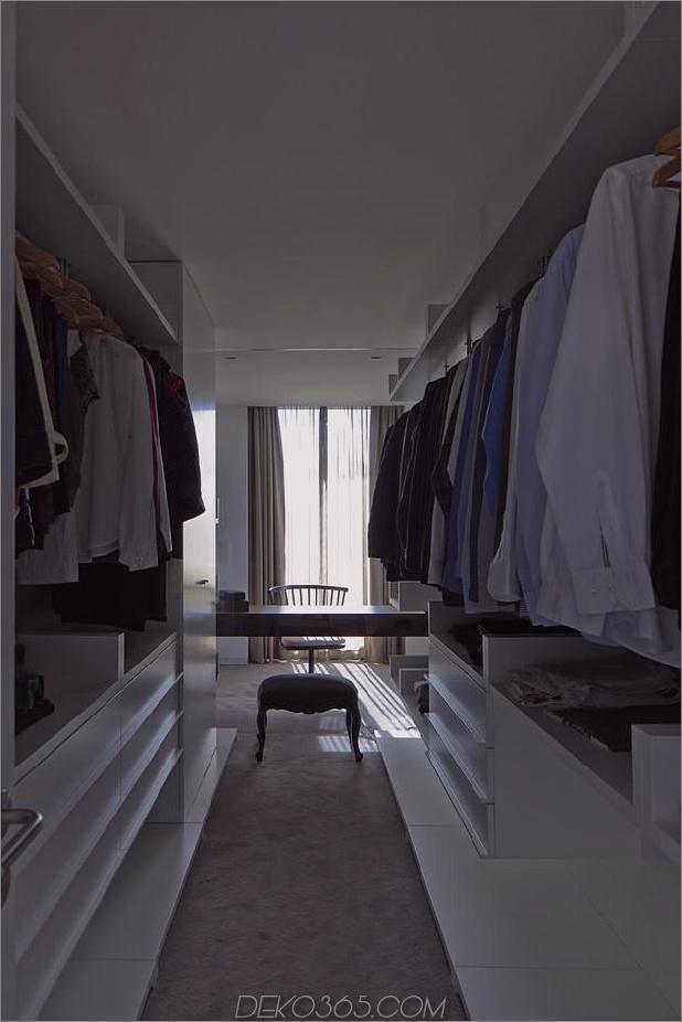 black-home-with-bright-interior-einbau in grasige hügel-27-closet.jpg