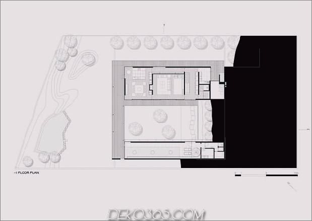 black-home-with-bright-interior-eingebaut in grasige hügelseite-30-floor-floor.jpg