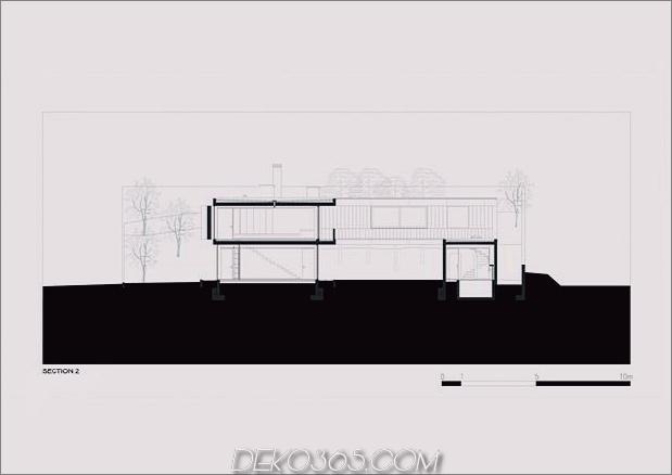 black-home-with-bright-interior-eingebaut in grasige hügelseite-34-rear-facade.jpg